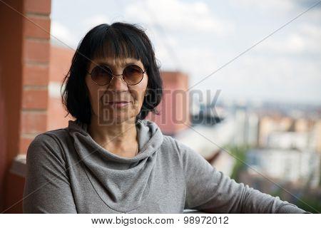 Senior pensioner woman in sunglasses