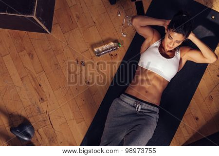 Muscular Woman Doing Sit-ups In Gym