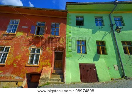 Red And Green Wall With Windows House Building In Sighisoara, Romania