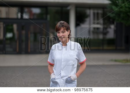 Young Nurse Outside The Hospital Smiling At Camera