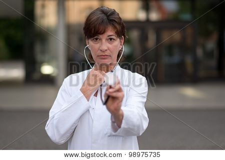 Cardiologist Or Doctor Holding A Stethoscope