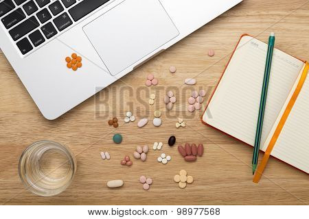 Laptop pc and colorfull pills