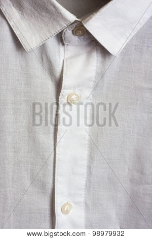 White shirt close up. Collar and buttons