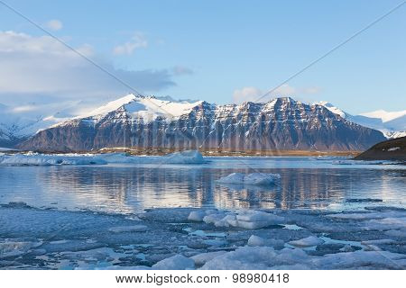 Jokulsarlon ice lake with snow mountain background, Iceland