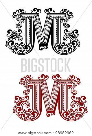 Letter M decorated with swirl ornaments