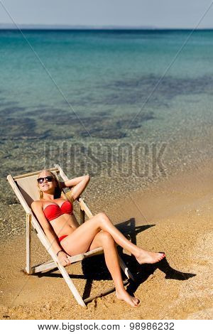 Young Woman In The Chair At The Beach