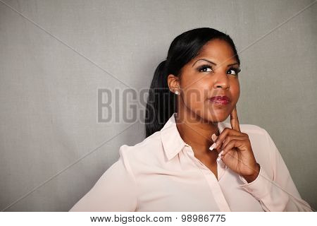 Reflective Woman Contemplating With Hand On Chin