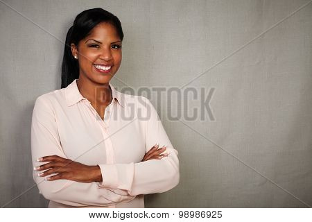 Charismatic Female Smiling With Arms Crossed