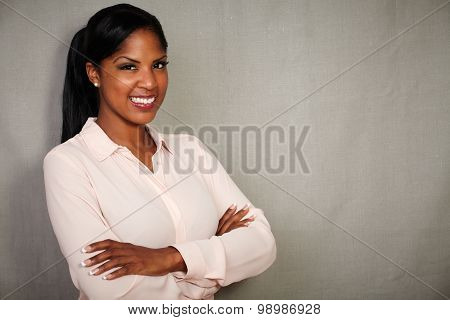 Professional Woman Smiling With Arms Crossed