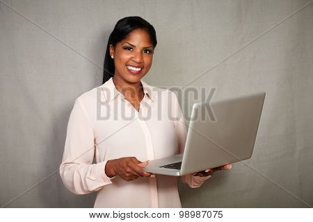 Confident Young Businesswoman Holding A Laptop