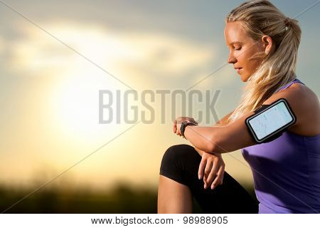 Young Girl Checking Workout On Smart Watch At Sunset.