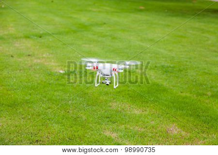 flying drone with camera on the green grass prepair to fly