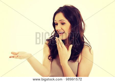 Young student laughing woman with empty palm.