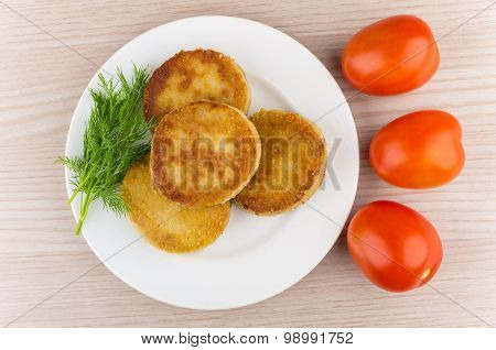 Prepared Cutlets In Plate With Dill And Tomatoes