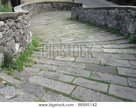 Descent Stone Walkway Of Medieval Bridge Known As Ponte Del Diavolo In Borgo A Mozzano, Italy