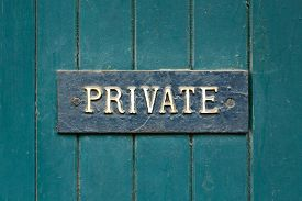 stock photo of entryway  - Closeup of a private sign on an old wooden door painted green - JPG