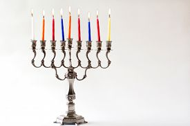 stock photo of hanukkah  - Lit Hanukkah menorah during the eighth last and final day of the Jewish holiday of Hanukkah - JPG