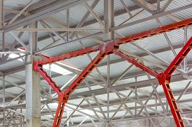 stock photo of canopy roof  - metal frame of the roof of industrial premises in the enterprise inside view - JPG