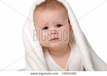 The crying baby under a towel