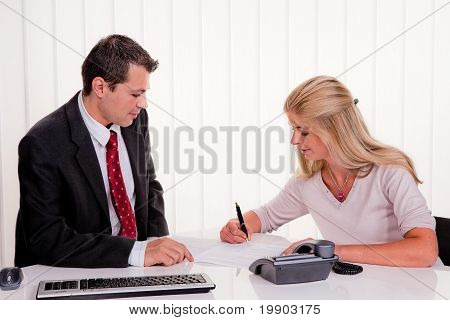 Woman signs a contract