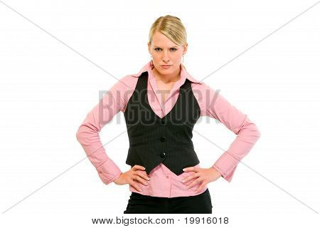 Authoritative modern business woman with hands on hips isolated on white
