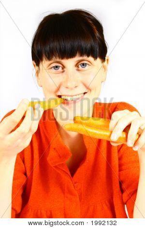 Young Girl Eating Fresh Carrot