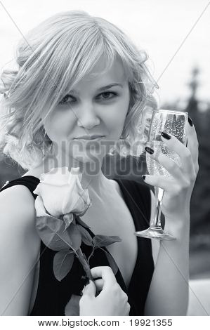Portrait Of A Beautiful Woman With Rose And Champagne Wineglass