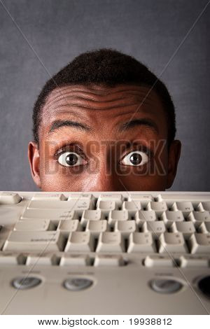 Surprised Eyes Of Man Above Keyboard