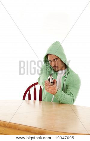 Man At Table With Gun