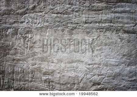 limestone wall with scratches