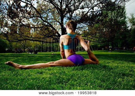 Young Pretty Woman Wearing Sunglasses , Doing Yoga And Having Fun In Central Park