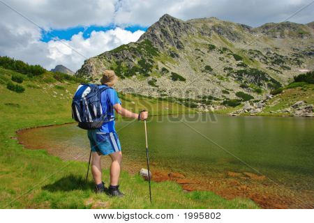 Hiker At Prevalski Lake In National Park Pirin