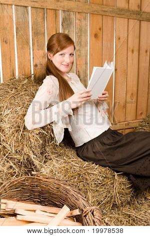 Young Romantic Woman Read Book In Barn