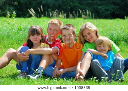 Happy Kids In A Meadow