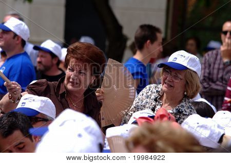 People attending a political meeting 05