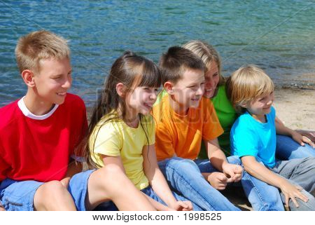 Smiling Children By A Lake