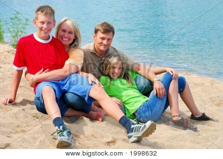Happy Family By The Lake