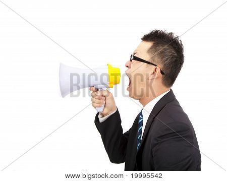young Businessman make loud noise by megaphone