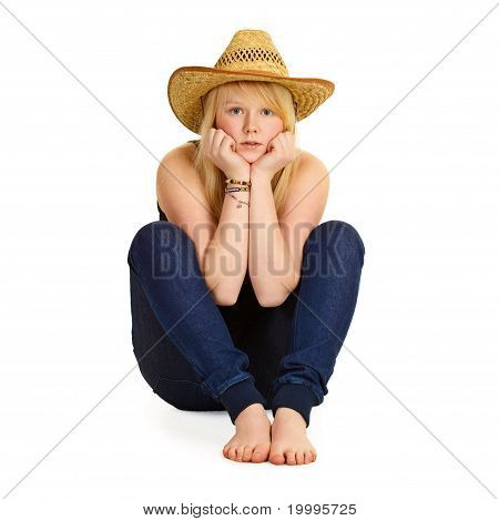 Young Blonde In Straw Hat Sitting On Floor