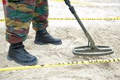 picture of landmines  - Looking for buried explosive mines - JPG