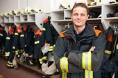 stock photo of firefighter  - Picture from a young and successful firefighter - JPG