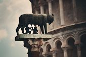 Leaning tower with Capitoline Wolf (or she-wolf) sculpture in Pisa, Italy as the worldwide known lan poster