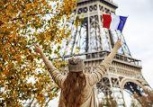 Elegant Woman On Embankment In Paris, France Rising Flag poster