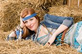 Young Hippie Woman Lying On Hay Relax