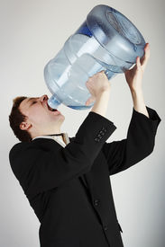 pic of drinking water  - Man drinking water from huge water bottle - JPG