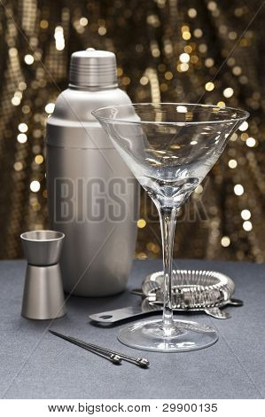 One Martini Glass With Bartender Tools