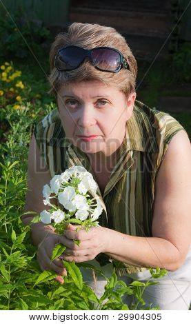 Portrait Of A Woman With A  Phlox