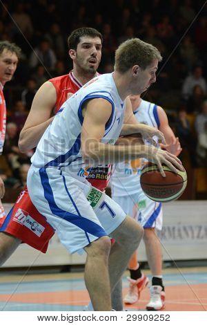 KAPOSVAR, HUNGARY - JANUARY 28: Daniel Koma (white 7) in action at a Hungarian Championship basketball game with Kaposvar (white) vs. Nyiregyhaza (red) on January 28, 2012 in Kaposvar, Hungary.