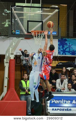 KAPOSVAR, HUNGARY - JANUARY 28: Michael Fey (white 34) in action at a Hungarian Championship basketball game with Kaposvar (white) vs. Nyiregyhaza (red) on January 28, 2012 in Kaposvar, Hungary.