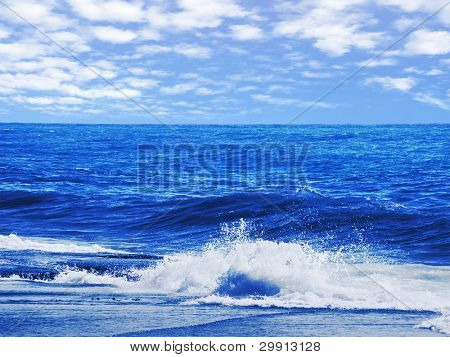 sea waves splashing on the shore on a bright day (water series B)